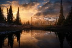An epic display of light at Tipsoo Lake as clouds hide Mt. Rainier in the distance [OC] [1200800] #reddit