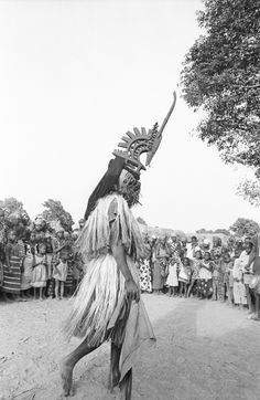 Masked performer wearing male Chi wara headdress, Bamako (national district), Mali, Creator: Elisofon, Eliot photographer.