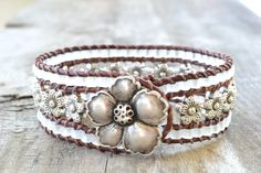 """Items similar to Country girl beaded cuff bracelet """"Silver flowers and White Sea Glass beads"""", distressed brown leather, very rustic-boho chic on Etsy. , via Etsy."""