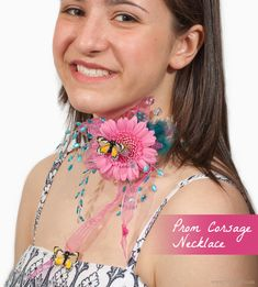 Leave your hands free to dance! Necklace corsage with a pink gerbera daisy and butterflies for Prom, Homecoming, and other special events. This choker band can also be worn on your arm or leg, or in your hair.