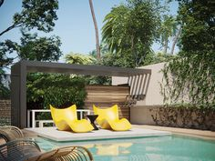 "Vondom's bright yellow ""Surf Sun"" chaises from Clima Outdoor sit on a thick cantilevered concrete sundeck by the lap pool. The linear iron pergola, coated in copper, provides a degree of overhead shade."
