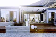 Take a Stroll Through a Malibu Marvel Tucked Into the Mountains | DomaineHome.com // Indoor/outdoor living set up in a Blu Homes prefab.