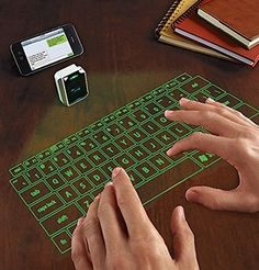 Virtual laser keyboard for iphone or smartphone. Pretty cool tech/gadget!