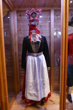 The traditional Bunad (the traditional dress of Norway) for the women includes a skirt worn with a highly embroidered blouse, over which is worn a much decorated vest or bodice of silk damask or calamanco. Some women also use a shawl over one shoulder. Similarly, the Norwegian men wear a knicker-length or full-length pants of one color in their Bunad. They also wear a plain jacket, made in the same material as their trousers. The buttons on the man's vest, coat and pants are stamped pewter