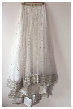 """Assymetrical net skirt with pearl, dabka and stone border on waist. Fishnet style border at the bottom. """"The peach project by ayesha"""""""