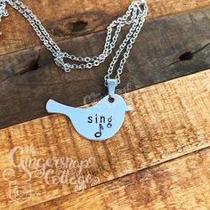 Hand Stamped Bird Shaped Necklace, Sing, Musical Note  If you have a song in your heart, this beautiful bird shaped necklace is just right for you!  I cut this bird shaped pendant myself, from lightweight, tarnish free aluminum, which has been coated on the front for a mirror finish.  It measures a