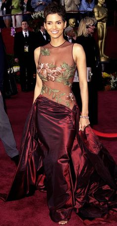 Halle Berry, 2002  Halle Berry knows how to do classy and sexy. The night she won an Oscar for Monster's Ball, the actress highlighted her amazing figure with a peek-a-boo embroidered gown from up-and-coming designer Elie Saab.