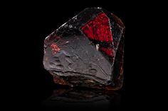 Zircon from Mavumbi, Tanga District, Tanzania _ 3,0 x 1,0 x 4,5 cm .Main crystal size : 4,2 cm Sharp transparent crystal with a beautiful red-brown color and some internal veils near the base © MIM Museum ,Beirut - Photo Augustin de Valence