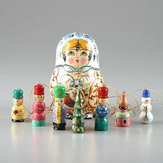 This attractive and fun ornaments doll was imported directly from Russia. It is hand-crafted by Russian artist from a birch wood. Open this nesting doll up and it reveals a set of small Christmas ornaments. Each one is is individually carved and painted. Makes a unique gift idea or collectible accent for any home.