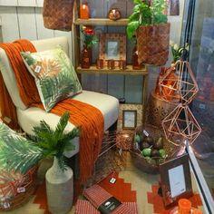 Orange and copper shop display. New window display at Lavish Abode June 15. Visual merchandising. VM. Retail store window display. Home. Decor.