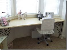 Sewing desk/table at a bay window. I wish I knew how to make something like this for the bay window in my art room....but I live in an apartment so I don't want to have anything permanent, just in case.