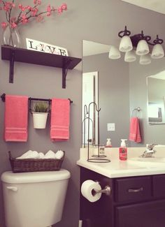 Shelf, towel rack, basket, above toilet space. Add decoration along with organization.
