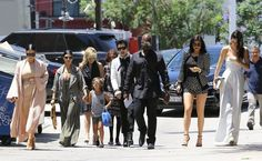 The Kardashian Clan Watches 'The Phantom of the Opera' - The 'Keeping Up With The Kardashians' clan are spotted at the Pantages Theatre in Hollywood, California to watch 'The Phantom of the Opera' on July 26, 2015. Kim, who is currently pregnant with her second child, hid her growing baby bump under a tight beige dress.