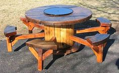 Here we have another awesome pallet cable spool/reel furniture idea for your patio decor. This nice picnic table is perfect for a casual family gathering in the garden or patio. The table in the center is in the spool shape, but you need to cut the benches and nail them with the table. You may polish it and smooth the surface for a nice impact.