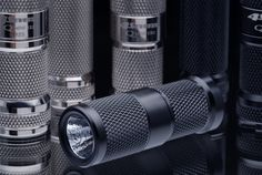 4Sevens MiNi CR2 keychain flashlight. Even smaller than the 123, but still throws out a respectable 180 lumens. $39