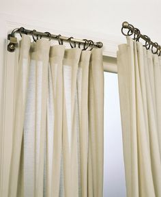Replace your curtain rods with swing arm rods to open up the room and allow more light in. Windows appear to be bigger than they are, too. Love swing arm curtain rods, I have been on the hunt for old ones for a long time.