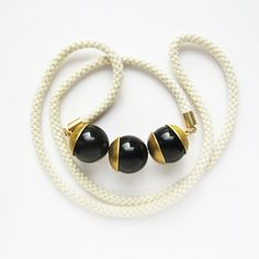 Ivory Mokuba rope and three onix beads