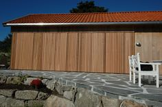 Cladding in red cedar wood. The folding shutters are closed. Cedar Cladding, Red Cedar Wood, Old Farm, Large Windows, Shutters, Facade, Garage Doors, Outdoor Decor, Inspiration
