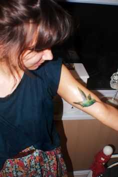 Small Humming Bird Tattoo On Arm For Girls