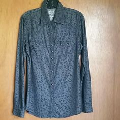 Rock 47 western button up  NWOT A fresh update to the trendy animal print, this one is grey with black splotches. This blouse is a button down with long sleeves and a gently curved hemline. Wear it tucked in or out, almost tunic length, looks great both ways. This is a western style Rock 47 by Wrangler shirt with black faux crystal snap buttons. Wrangler Tops Button Down Shirts