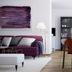 Purple sofa in living room. #decoration #painting