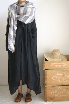 Love the dress and striped scarf. Cool, comfortable style. Would pair with black ankle boots or some other shoes, though.