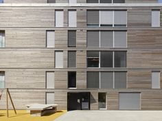Completed in 2014 in Lausanne, Switzerland. Images by Michel Bonvin . The project is located in the neigborhood of Faverges in Lausanne, just next to a small river. Built on a site owned by the City of Lausanne, for the. Social Housing Architecture, Innovative Architecture, Wood Architecture, Architecture Details, Lausanne, Facade Design, Exterior Design, Metal Facade, Student House