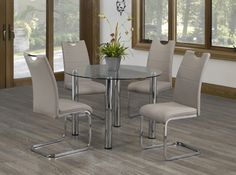MODERN CHROME AND CAPPUCCINO DINETTE - This hip dinette sports a beautiful chrome table and chairs that feature a cappuccino leatherette and handlebar tops.