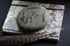 A Buffalo engraved on a beautiful 5 wide River Stone. The stone is a natural dark brownish color. A perfect addition for any office space or