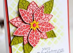 Hello! As we are nearing the Holiday season, my thoughts have turned to creating Christmas cards to send to my friends and family. This lovely card was created with the beautiful Luxe Poinsettia outline and background dies. I first printed a sentiment from my computer, and stenciled the background with the Texture Tessatina designer stencil from Memory Box. After that I cut the poinsettia background out of the light green color, and both shades of the red. I cut the poinsettia outline out of…