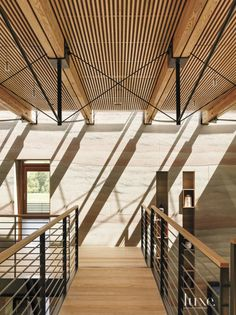 Wood slatted screens—constructed by the project's builder, David Stocker—filter the sunlight and help to control the interior temperature. The stainless-steel railing was made by Stocker and API Custom Metal Fabrication.