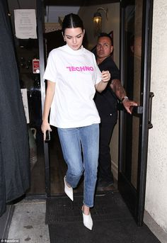 Harmonious: Kendall Jenner left the restaurant in a plain statement T-shirt that declared ...