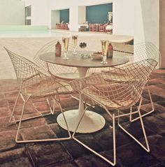 The Diamond chair is often thought of as patio furniture but we love them indoors just as much.