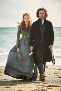 Besotted:Further shots see the couple stroll along the beach hand-in-hand as a gesture of unity against the turbulent season two