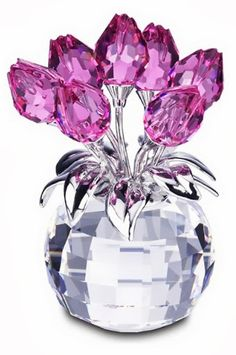 Swarovski Crystal Tulips Figurine - Im a lucky girl....I have this one. Made for Breast Cancer Awareness.