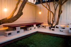 Stack Cinder Blocks for Easy Outdoor Seating - Cool Backyard Ideas: 19 Free Upgrades for Your Outdoor Living Room - Bob Vila Cinder Block Furniture, Cinder Block Bench, Cinder Block Garden, Cinder Blocks, Backyard Lighting, Backyard Projects, Diy Projects, Backyard Patio, Backyard Designs