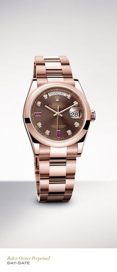 The Rolex Day-Date 36mm in 18 ct Everose gold with a doomed bezel gem-set chocolate dial and Oyster bracelet. #Festive #RolexOfficial