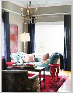 Everything about this room - from pink claw-footed end tables to beautiful pale blue couch to bright pink rug - is <3