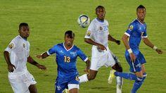 Democratic Republic of the Congo's midfielder Nelson Munganga Omba and Democratic Republic of the Congo's midfielder Mabidi Lema challenge Cape Verde's midfielder Luis Soares
