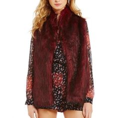 Gianni Bini faux fur vest Brand new with tags! Various sizes available so check out my closet. It has more of a box for in person in my opinion but fit will vary on body type. Gianni Bini Jackets & Coats Vests