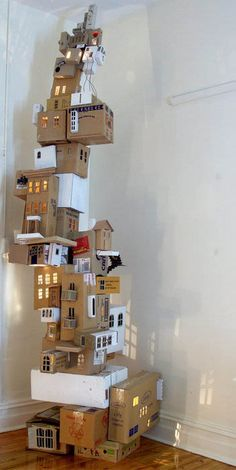 Amazing box Craft - Start with a bunch of small boxes of different sizes, preferably blank on the outside. The kids have to work together to create a tower village like the one pictured.