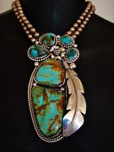 Chavez - navajo. The turquoise and sterling silver medallion are a superb representation of the Navajo Jewelry Art and Tradition... The Chavez have been making jewelry for decades and decades.