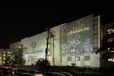 The campus of Hindustan Unilever, Mumbai, lit up at night. The campus, designed by Kapadia Associates, wears its public identity on its sleeve, as it were -- the large glass screen printed with abstracted elements from the company logo.