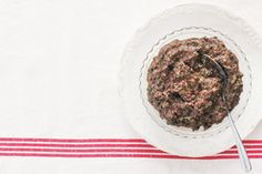 A leg of ham served with plenty of bread, salad greens and accompaniments such as this tapenade, make a casual buffet meal. They're also handy fridge fixings for holiday sandwiches.