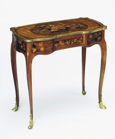 Mechanical writing table Oeben, Jean-François France ca. 1760 Oak, veneered with tulipwood, with marquetry of rosewood, sycamore, purplewood, boxwood, ebony, tulipwood and others; in part stained, shaded and engraved with gilt bronze mounts