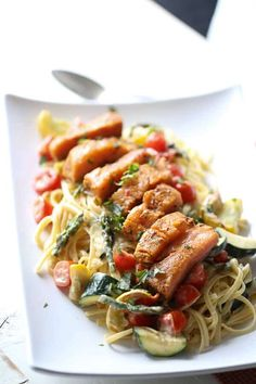 This salmon topped pasta Primavera is filled with veggies and tossed with a light, creamy sauce. A simple, elegant meal for any occasion. The recipe's here!