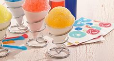 Start with a simple syrup then add orange extract and food colors for fruity shaved ices to beat the summer heat.