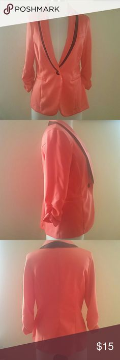 EUC Tuxedo Style Blazer by Lauren Charlotte Russe EUC Tuxedo Style Blazer by Lauren Charlotte Russe. Vibrant salmon color with black lapel detailing. True size Large. Gathered sleeves make a perfect fit. Dress it up or pair it up with jeans. Thanks for looking! Charlotte Russe Jackets & Coats Blazers