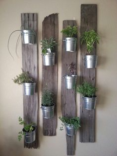 Creative Indoor Vertical Wall Gardens • Lots of Great Ideas and Tutorials! Including, this idea of small tin buckets attached to repurposed wood. Love this look! #herbgardenindoorplanters
