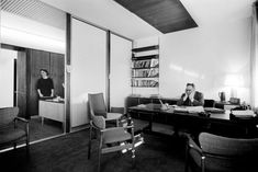 Let's travel back to the 1960s—a time when everything was in grayscale—and breathe in a bit of the decadent air suffusing Don Draper's work life. Looks like that fellow on the right needs a break—so let's stretch our legs and take a stroll around the office with him.
